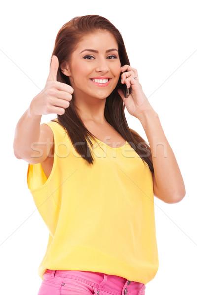 Téléphone femme isolé blanche heureux Photo stock © feedough