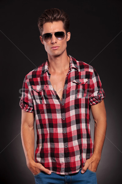 fashion man wearing sunglasses with hands in pockets Stock photo © feedough