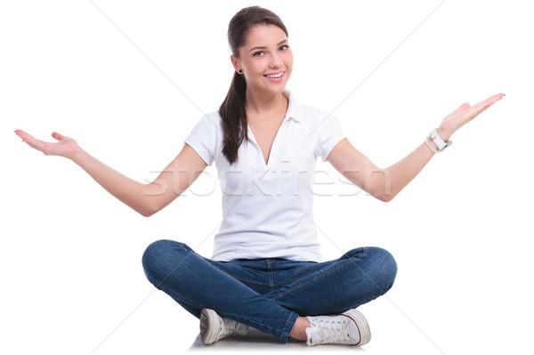casual woman welcoming seated Stock photo © feedough