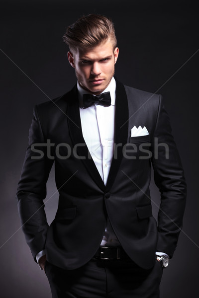 business man holds both hands in pockets Stock photo © feedough