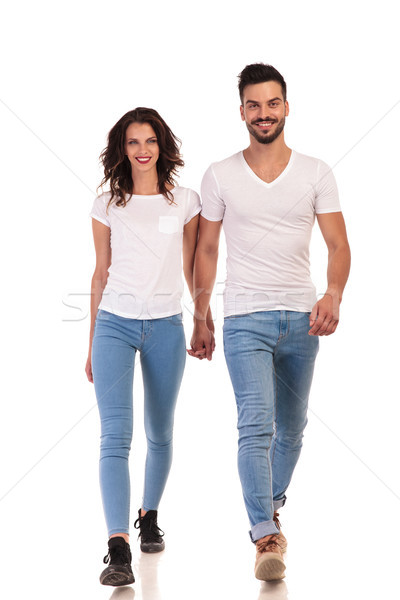 smiling young casual couple is walking forward  Stock photo © feedough