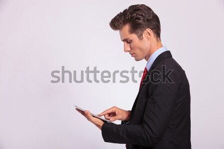 man browsing on touch screen Stock photo © feedough