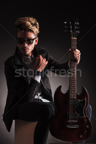 serious guitarist wearing sunglasses is sitting Stock photo © feedough