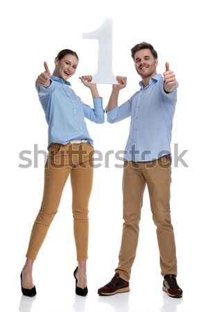 excited young casual couple holding blank board and celebrate su Stock photo © feedough