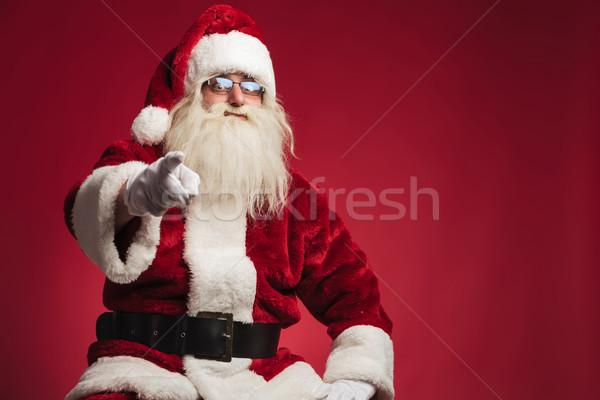 сидящий Дед Мороз указывая пальца красный студию Сток-фото © feedough