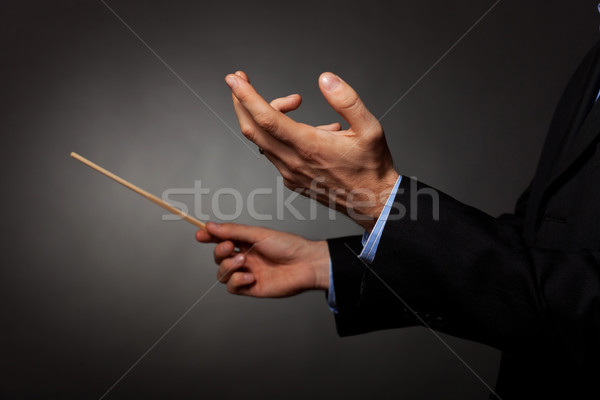 Stock photo: male music conductor directing
