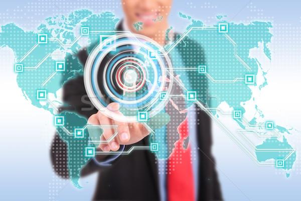 business man pushing virtual buttons Stock photo © feedough