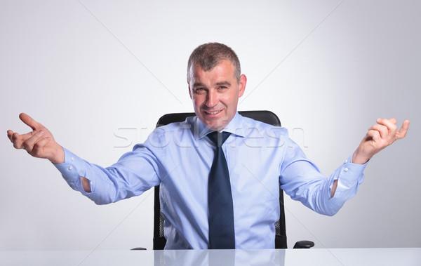 senior business man welcomes you form desk Stock photo © feedough