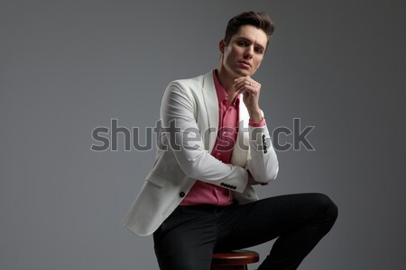 seated young man with beard looks away Stock photo © feedough