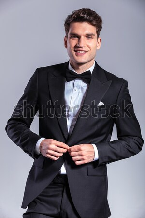 smiling business man with hands in his pockets Stock photo © feedough