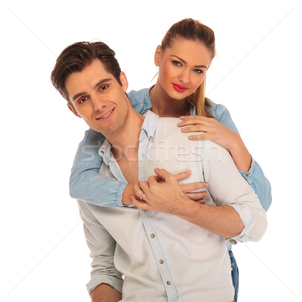 beautiful girl embracing man from behind Stock photo © feedough