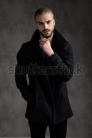 relaxed elegant man with hands in pockets wearing tuxedo Stock photo © feedough