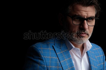 attractive smart casual man fixing his glasses is skeptical Stock photo © feedough