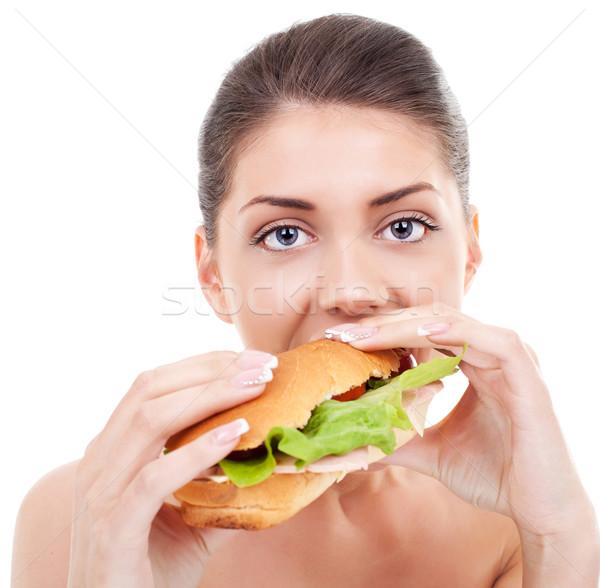 Fiatal nő elvesz nagy falat szendvics közelkép Stock fotó © feedough