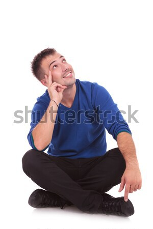 pensive man sitting and looking up Stock photo © feedough