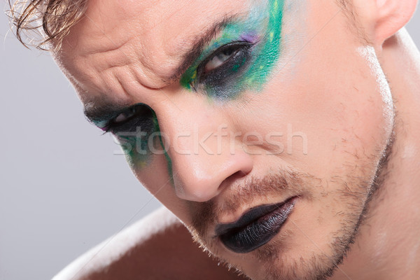 casual man with makeup stares at camera Stock photo © feedough