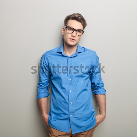 dramatic fashion male model holding his collar  Stock photo © feedough