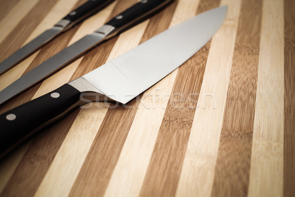 chef's knife and  other smaller knives on  cutting board  Stock photo © feedough