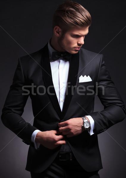 business man buttons his tuxedo jacket Stock photo © feedough