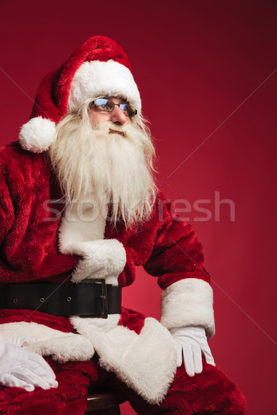 cutout side image of santa claus sitting on a chair Stock photo © feedough
