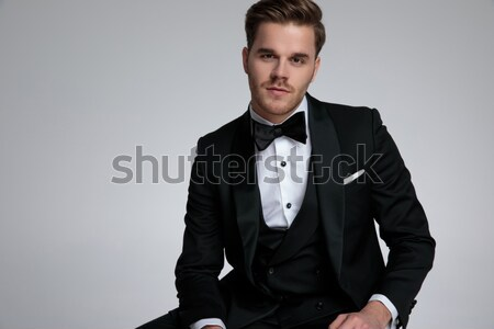 sexy formal businessman buttoning his black suit jacket Stock photo © feedough