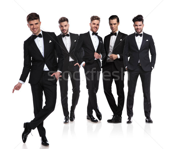 elegant leader stands in front of grooms and snaps finger Stock photo © feedough