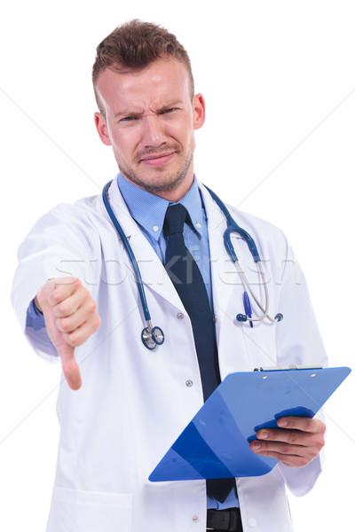 Genç doktor kötü haber negatif başparmak Stok fotoğraf © feedough