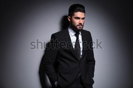 Atrakcyjny młody człowiek elegancki czarny garnitur muszka Zdjęcia stock © feedough
