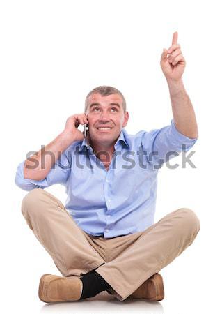 молодые случайный человека телефон молодым человеком сидят Сток-фото © feedough
