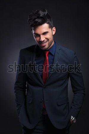 Happy business man holding his fist up Stock photo © feedough