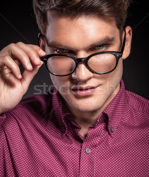 handsome casual man taking off his glasses Stock photo © feedough