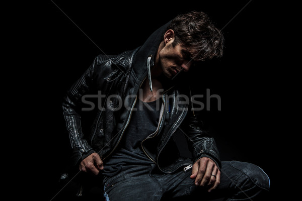 side view of a man wearing hoodie and leather jacket Stock photo © feedough