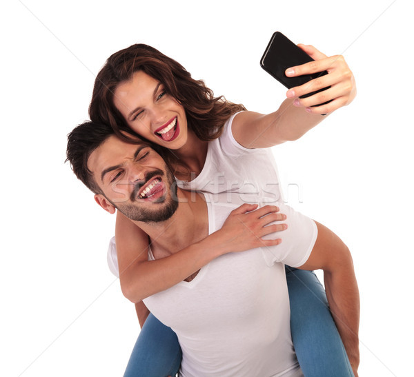 happy couple having fun with their selfies Stock photo © feedough