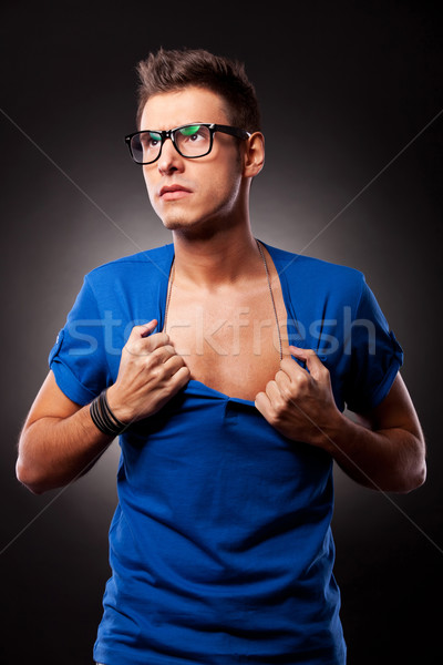 young man ripping his blue shirt Stock photo © feedough