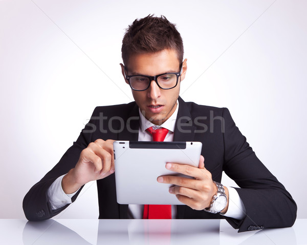 business man selecting something on his electronic pad Stock photo © feedough