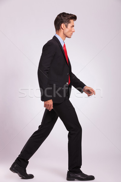 side view of man walking & looking away Stock photo © feedough