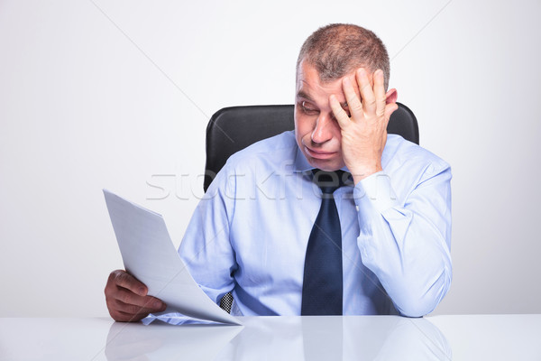 old business man disappointed by reports Stock photo © feedough