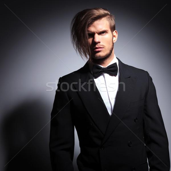 dramatic elegant man in tuxedo and bow tie Stock photo © feedough