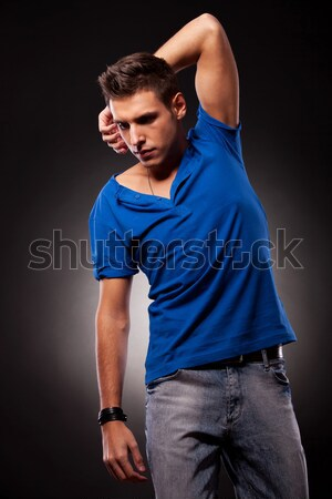 handsome man sitting and fixing his hair with both hands Stock photo © feedough
