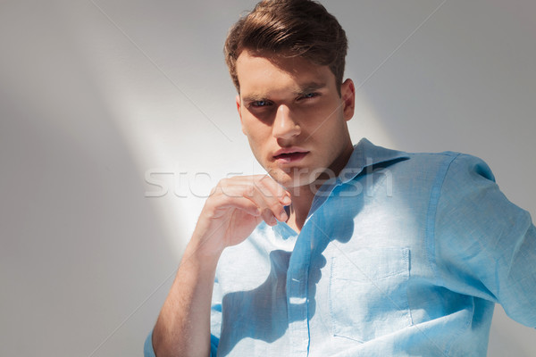 Arrogant young casual man looking at the camera Stock photo © feedough