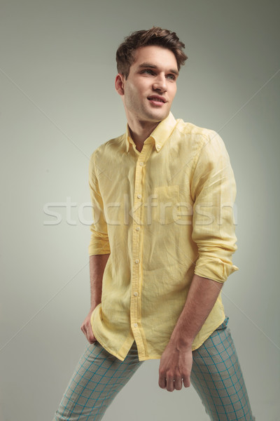 Side view of a smiling young fashion man Stock photo © feedough