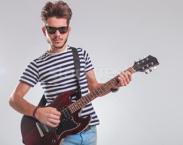 artist posing while leaning and playing electric guitar Stock photo © feedough