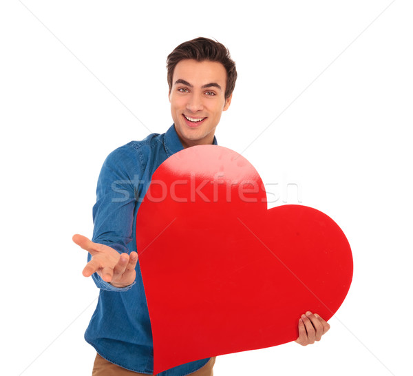 smiling young casual man inviting you to love him Stock photo © feedough