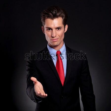 young man closing his tuxedo coat and looks away Stock photo © feedough