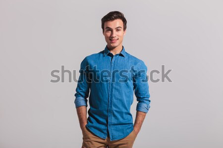 casual man leaning on wall and looks down  Stock photo © feedough