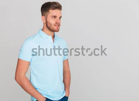 portrait of relaxed young man wearing light blue polo t-shirt Stock photo © feedough