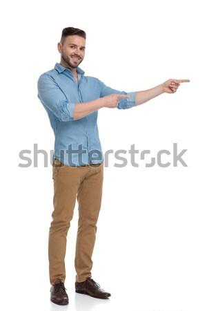 Egészalakos kép mosolyog lezser férfi mutat Stock fotó © feedough