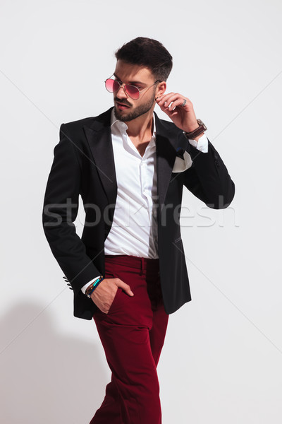 stylish young man stepping to side and looking behind Stock photo © feedough