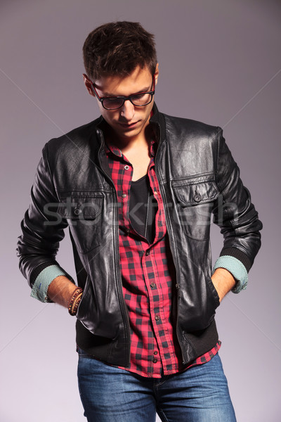 casual young man with hands in pockets Stock photo © feedough