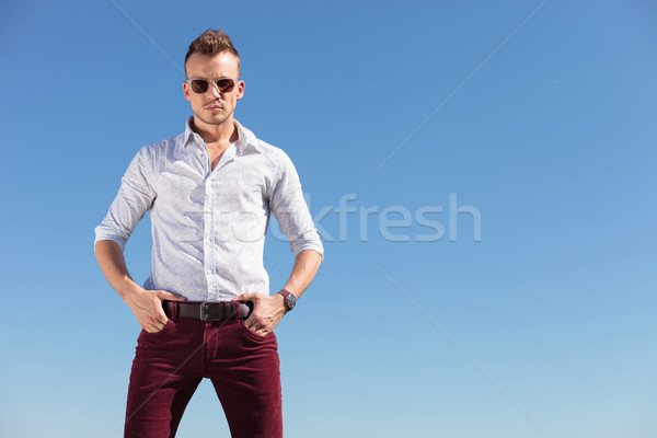casual man with hands in pocket in front of blue sky Stock photo © feedough